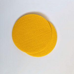 vrolijk geel haalt het zonnetje in huis, set van vier ronde onderzetters
